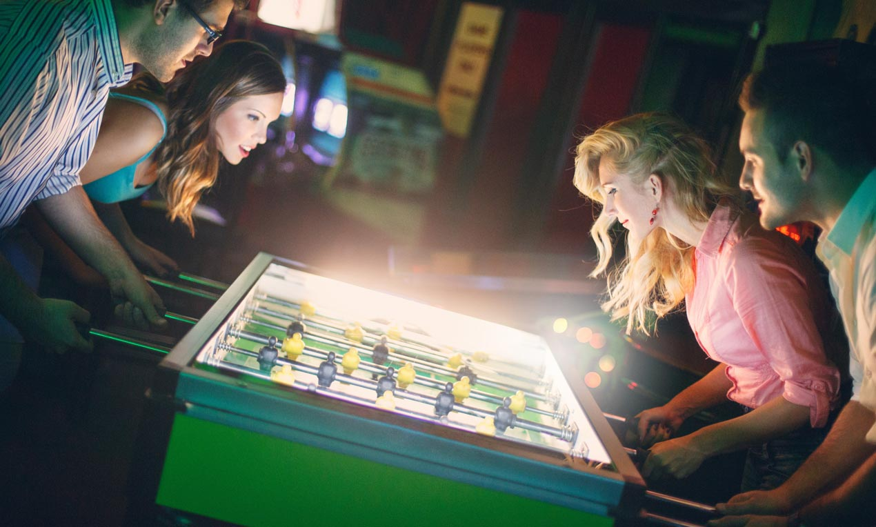friends playing fooseball